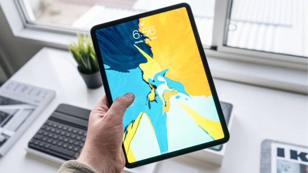Apple iPad Pro In a Person Hand